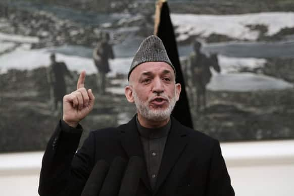 Afghan President Hamid Karzai speaks during a news conference in Kabul. Karzai says the director of the CIA assured him that regular funding his government receives from the agency will not be cut off.