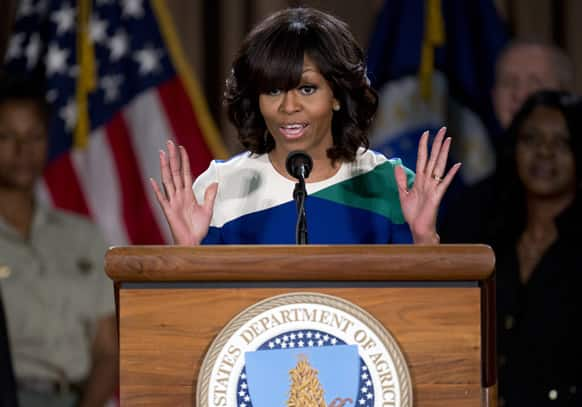 First lady Michelle Obama gestures as she speaks at the Agriculture Department in Washington.