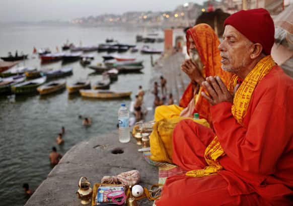 Hindu devotees offer prayers in the morning on the banks of the holy River Ganges in Varanasi.