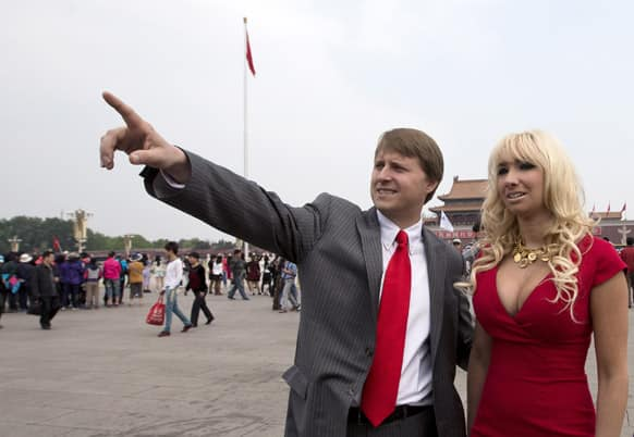 Christopher Cox, grandson of former US President Richard Nixon and his wife Andrea Catsimatidis tour at Tiananmen Square in Beijing. A delegation led by Cox and former US officials are here to commemorate the late US President`s centennial by retracing the 1972 historical visit to China.