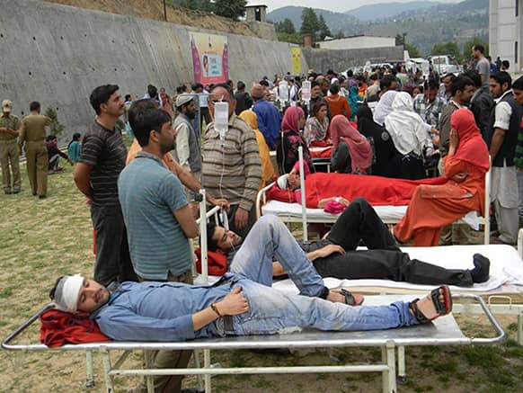 Patients are evacuated from a hospital after a magnitude-5.4 earthquake in Bhaderwah area, in Indian-controlled Kashmir.