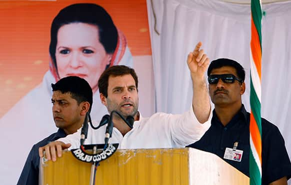 Congress party leader Rahul Gandhi, center, flanked by security personnel speaks during a campaign rally for the upcoming state elections in Tumkur, 70 Kilometers (43 miles) northwest of Bangalore.