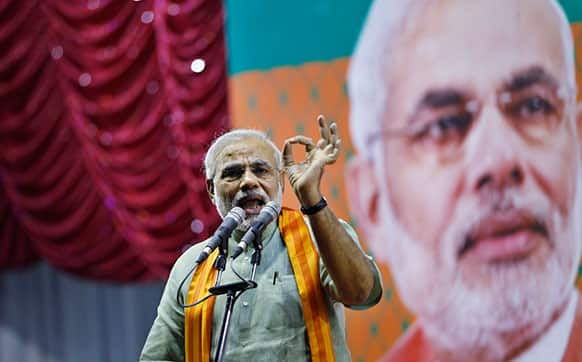 India`s main opposition Hindu nationalist Bharatiya Janata Party (BJP) leader Narendra Modi speaks during a campaign rally for the upcoming state elections in Bangalore.
