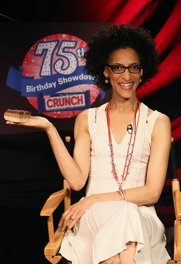 Carla Hall holds the winning treat, baked by Sweet Mandy B`s, at the Nestle Crunch 75th Birthday Showdown in Los Angeles.
