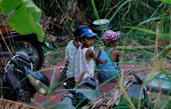 Muslim children take refuge in forests along a road in Okkan, about 70 miles (110 kilometers) north of Yangon, Myanmar.