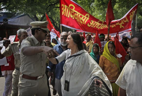 Communist Party of India leader Brinda Karat argues with a police officer as she with other tribals participate in a march to highlight tribal people`s rights to land, forest and water surrounding their settlements, in New Delhi.