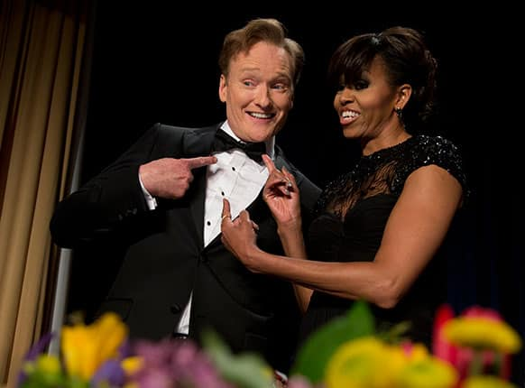 First lady Michelle Obama and late-night television host and comedian Conan O`Brien gesture to his tie at the White House Correspondents` Association Dinner at the Washington Hilton Hotel, in Washington.
