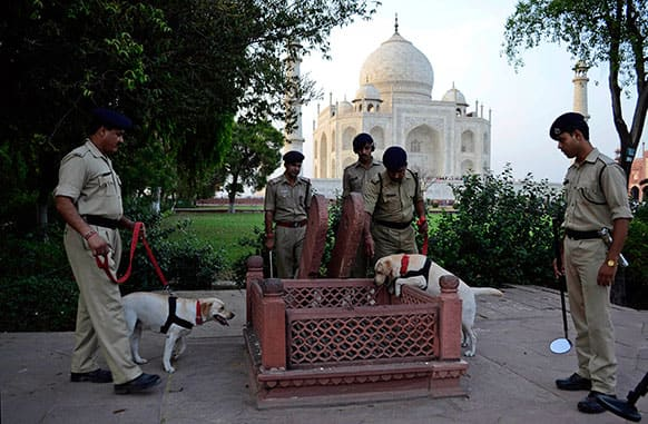 Security personnel conduct a routine patrol aroundthe Taj Mahal premises, in Agra.