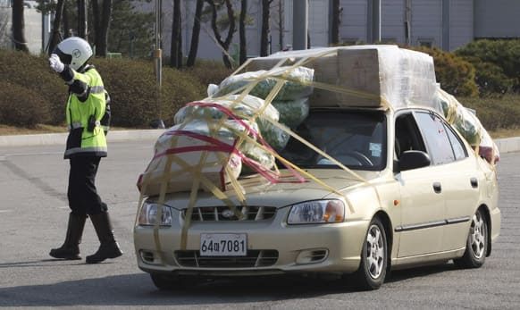 A South Korean vehicle fully loaded with goods and products brought back from North Korea`s Kaesong industrial complex arrives at the customs, immigration and quarantine office near the border village of Panmunjom in Paju, South Korea.