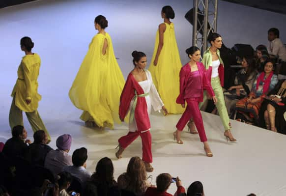 Pakistani models show creations of a brand `Sublime by Sara` during Lahore Fashion Week in Pakistan.