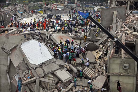 Bangladeshi rescuers work at the site of a building that collapsed Wednesday in Savar, near Dhaka, Bangladesh.