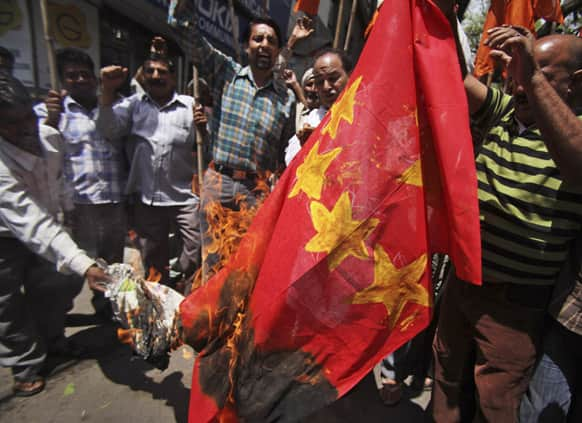 Activists of Shiv Sena burn a mock Chinese flag during a protest in Jammu.
