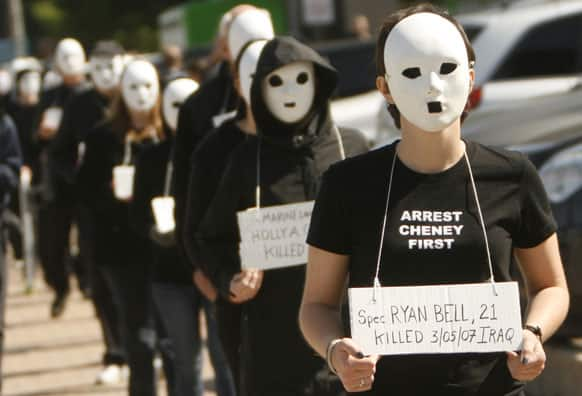 Protesters walk with masks on in Dallas near the dedication of the opening of the George W. Bush Presidential Center in Dallas.