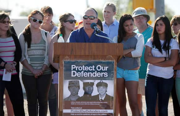 The protesters rallied to denounce the Air Force`s decision to transfer Lt. Col. James Wilkerson to Arizona after his sexual assault conviction was overturned by a commander, adding to the growing criticism of the military justice system.