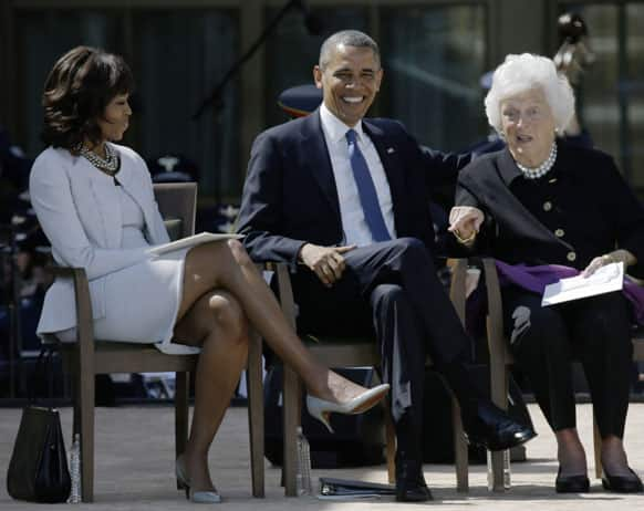 First Lady Michelle Obama and President Barack Obama, react as former first lady Barbara Bush gestures during the dedication of the George W. Bush Presidential Center, in Dallas.