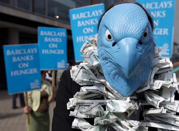 A protester, dressed to look like the Barclays Bank logo, demonstrates outside the Barclays Bank annual general meeting for shareholders, in central London.