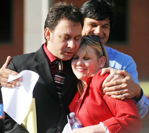 Paul Kevin Curtis, who had been in custody under suspicion of sending ricin-laced letters to President Barack Obama and others, hugs his attorney Christi McCoy during a news conference following his release in Oxford, Miss.