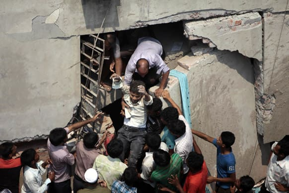 A man who was trapped in an collapsed eight-story building housing several garment factories is reccued in Savar, near Dhaka, Bangladesh.