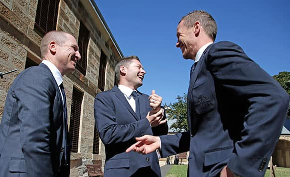 Australian test cricket captain Michael Clarke, center, laughs along with newly appointed vice captain Brad Haddin, left, and fast bowler Peter Siddle in Sydney, Australia,  following the announcement of the squad to tour England for the Ashes series.