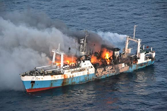 In this picture taken on Friday, April 19, 2013, released by Chile`s Air Force, Chinese factory fishing ship Kai Xin burnt just off the coast of Antarctica.