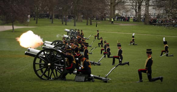 Members of the British military`s Kings Troop Royal Horse Artillery fire during a 41-gun royal salute to mark the 87th birthday of Britain`s Queen Elizabeth II in Green Park, London.