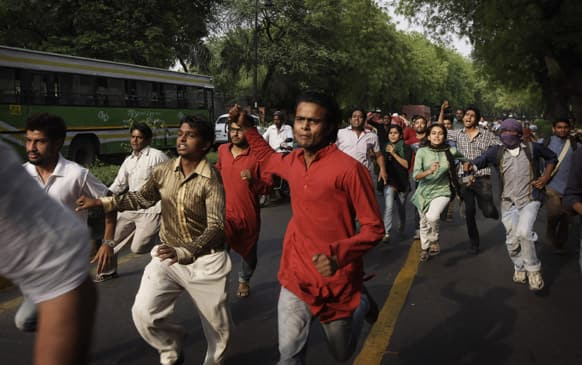 Protestors shouting slogans rush towards the Prime Minister`s residence during a protest against the rape of a 5-year-old girl in New Delhi.