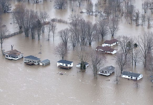 This Saturday, April 20, 2013, photo, provided by the Missouri Department of Public Safety shows flooding in LaGrange, Mo. The Mississippi River is topping out at some problematic spots, but there is growing concern that spring floods are far from over.