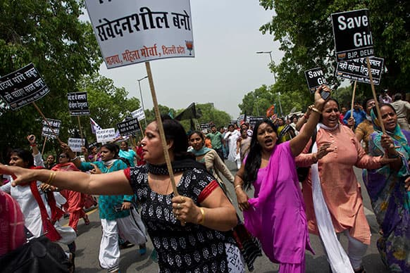 Women activists of India`s main opposition Bharatiya Janata Party shout slogans near the residence of ruling Congress party president Sonia Gandhi during a protest against the rape of a 5-year-old girl in New Delhi.