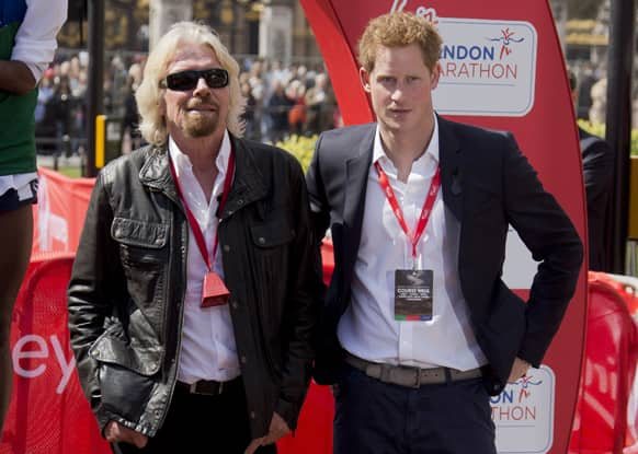 Britain`s Prince Harry and Sir Richard Branson, pose during this year`s Virgin London Marathon, in central London.