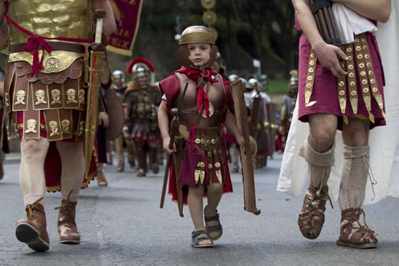 Ancient Roman costumed people parade in the ancient areas of Colosseum, Circus Maximus and the Roman Forum to celebrate the festivities of Christmas of Rome.