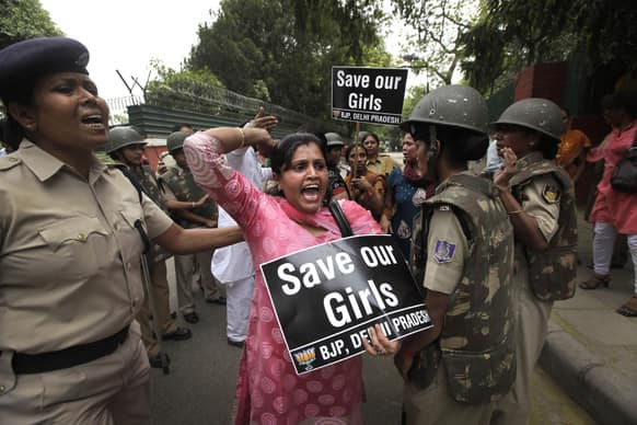 An Indian women activist of India main opposition Bharatiya Janata Party shouts slogans outside ruling United Progressive Alliance chairperson Sonia Gandhi's residence during a protest against the rape of a 5-year-old girl in New Delhi.