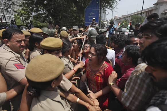 Protesters try to force their way inside Delhi Police headquarters during a protest against the rape of a 5-year-old girl in New Delhi.