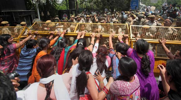 Protestors attempt to break through a barricade outside Delhi Police headquarters during a protest against the rape of a 5-year-old girl in New Delhi.
