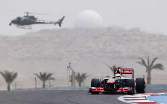 McLaren Mercedes driver Sergio Perez of Mexico rounds a corner during the third free practice ahead the Bahrain Formula One Grand Prix.