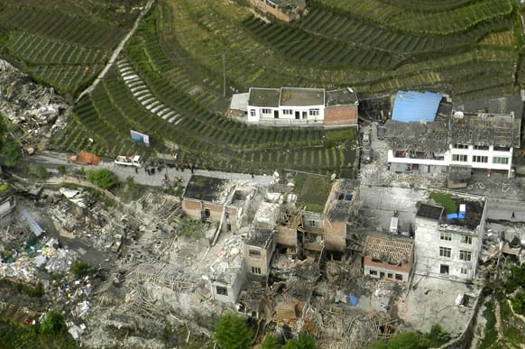 This aerial photo released by China`s Xinhua news agency shows destroyed houses after a powerful earthquake hit Taiping town of Lushan County in Ya`an City, southwest China`s Sichuan Province.