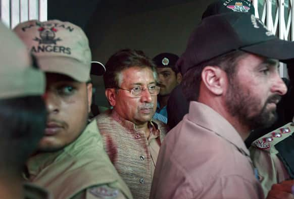 Paramilitary troops stand guard as Pakistan`s former President and military ruler Pervez Musharraf, center, leaves after appearing in an anti-terrorism court in Islamabad.