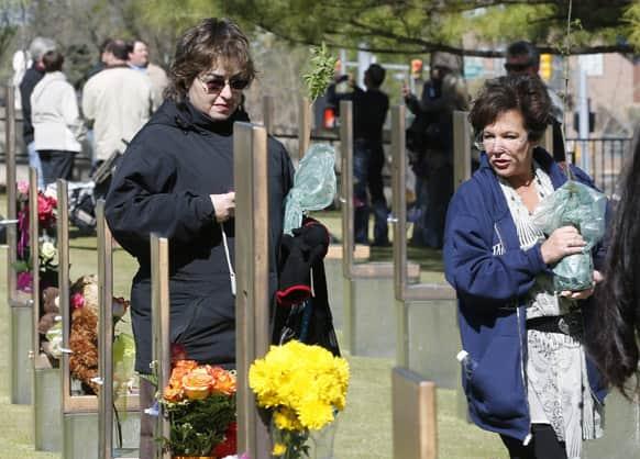 Lori Shulman, left, and Wendy Feinbert-Kotula, right,9-11 ambassadors, walk through the Field of Chairs at the Oklahoma City National Memorial in Oklahoma City.