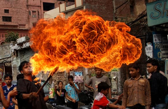 A boy blows fire during a religious procession to mark 'Ram Navami' festival in Amritsar. Ram Navami celebrates the birthday of Hindu god Rama.