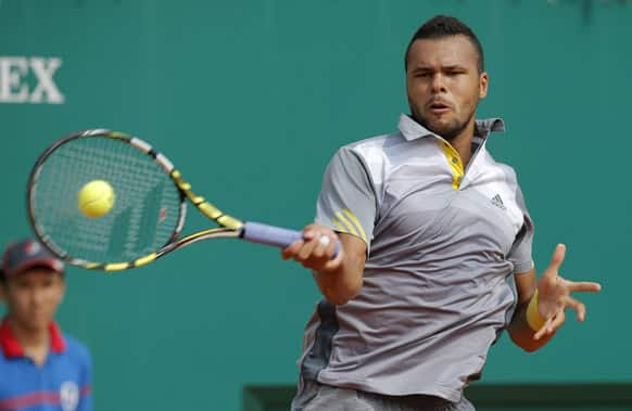 France`s Jo-Wilfried Tsonga plays a return to Stanislas Wawrinka of Switzerland during their quarter final match of the Monte Carlo Tennis Masters tournament in Monaco.