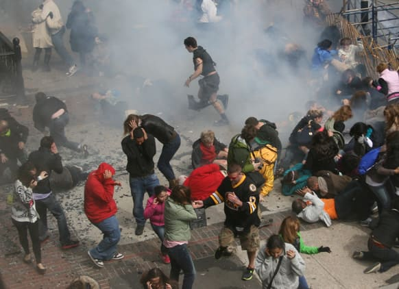 This photo provided by Ben Thorndike shows the scene following an explosion at the 2013 Boston Marathon in Boston.