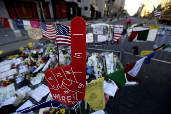 A foam finger stands at a makeshift memorial on Boylston Street in Boston, near the blast site of the Boston Marathon explosions.