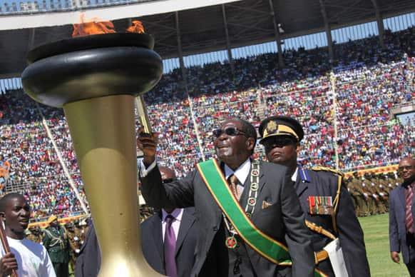 Zimbabwe`s President Robert Mugabe lights the independence flame during Zimbabwe`s 33rd independence celebrations in Harare.