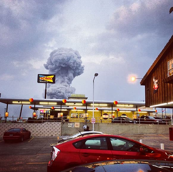 A plume of smoke rises from a fertiliser plant fire in West, Texas. An explosion at a fertiliser plant near Waco Wednesday night injured dozens of people and sent flames shooting high into the night sky, leaving the factory a smoldering ruin and causing major damage to surrounding buildings.