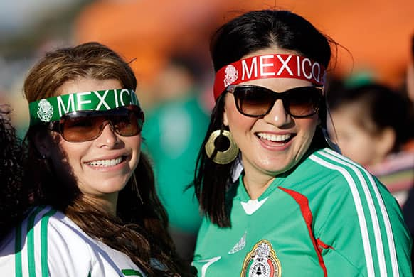 Mexico fans smile before an international friendly soccer match against Peru, in San Francisco.