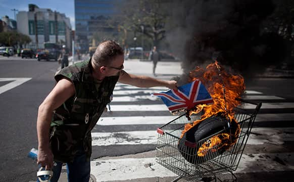 Argentina Falklands War veteran, Marcelo Wytrykusz, burns a Union Jack in protest in Buenos Aires, Argentina.
