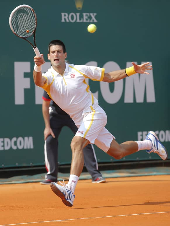 Novak Djokovic of Serbia plays a return to Mikhail Youzhny of Russia during their match of the Monte Carlo Tennis Masters tournament in Monaco.