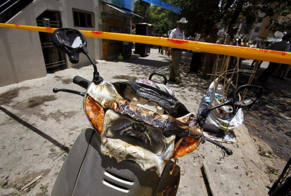 A partly charred scooter stands at the site of an explosion in a residential neighborhood near the office of Bharatiya Janata Party, in Bangalore.