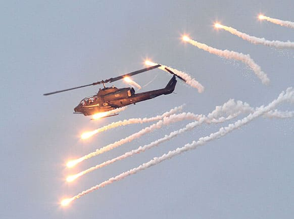 An AH-1W Attack Helicopter launches flares during Han Kuang military exercises in Penghu county, Taiwan.