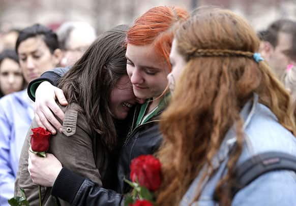 Emma MacDonald, 21, left, is comforted by Rachael Semplice, 22, center, as Juliana Hudson, 23, looks during a vigil for the victims of the Boston Marathon explosions.