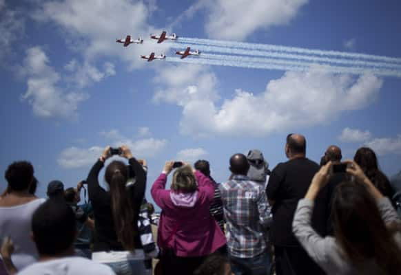 People take a photographs during Independence Day in Tel Aviv. Israel is celebrating its annual Independence Day, marking 65 years since the founding of the state in 1948.